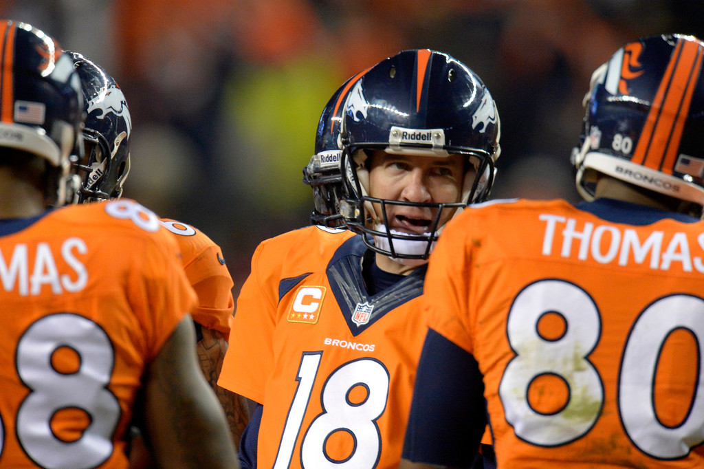 . Denver Broncos quarterback Peyton Manning (18) in the huddle during the first quarter. The Denver Broncos vs. the San Diego Chargers at Sports Authority Field at Mile High in Denver on December 12, 2013. (Photo by John Leyba/The Denver Post)