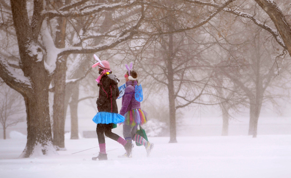 . DENVER, CO.- MARCH 23: Two people dressed in tutu\'s and bunny ears make their way through City Park. Snow arrived overnight in Denver and for much of Colorado with a foot or more expected in some areas of the foothills and eastern planes. (Photo By Kathryn Scott Osler/The Denver Post)