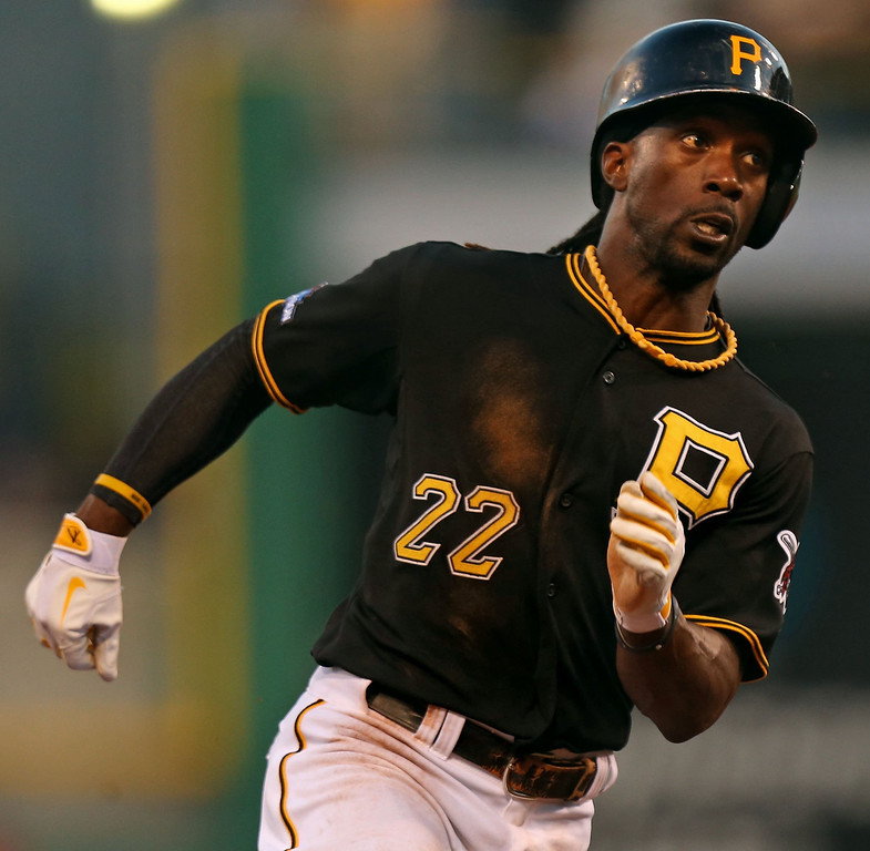 . Pittsburgh Pirates center fielder Andrew McCutchen advances to third off of a hit by right fielder Marlon Byrd against the St. Louis Cardinals during the sixth inning in Game 3 of the National League Division Series at PNC Park in Pittsburgh, Pennsylvania, on Sunday, October 6, 2013. (Huy Mach/St. Louis Post-Dispatch/MCT)