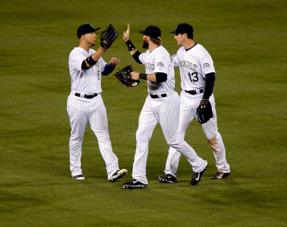 . DENVER, CO - MAY 15: Colorado outfielders Carlos Gonzalez, Charlie Blackmon, and Drew Stubbs celebrated the win. The Colorado Rockies defeated the San Diego Padres 3-1 at Coors Field  Friday night, May 16, 2014. (Photo by Karl Gehring/The Denver Post)