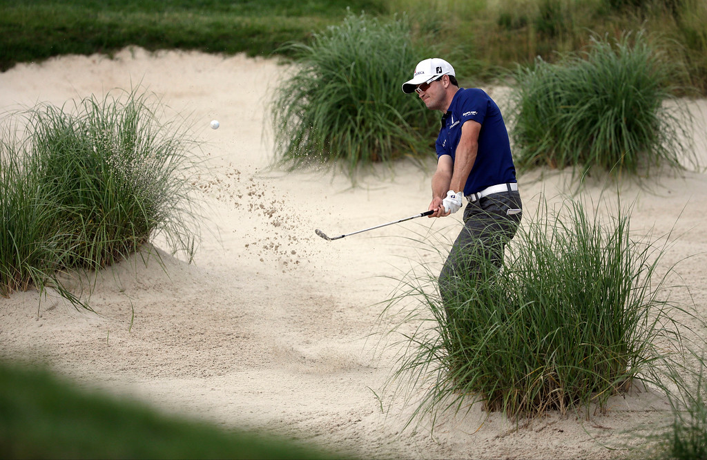 . Zach Johnson hits out of a bunker on the 10th hole during the second round of the U.S. Open golf tournament at Merion Golf Club, Friday, June 14, 2013, in Ardmore, Pa. (AP Photo/Gene J. Puskar)