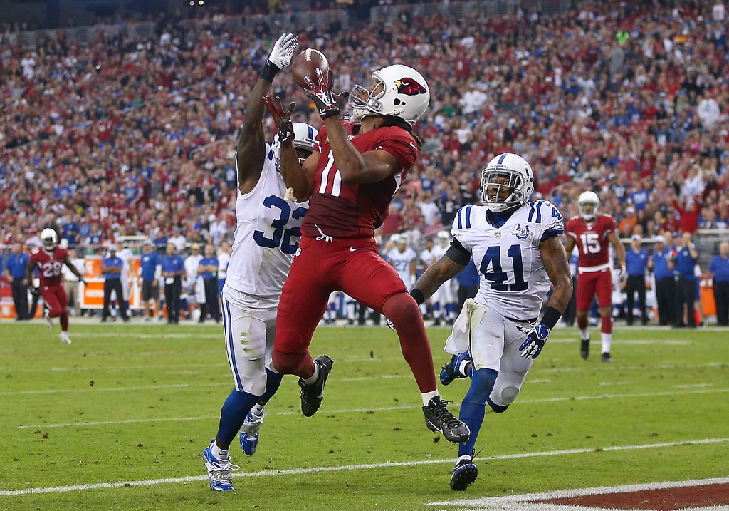 . Wide receiver Larry Fitzgerald #11 of the Arizona Cardinals catches a touchdown reception past cornerback Cassius Vaughn #32 strong safety Antoine Bethea #41 of the Indianapolis Colts during the second quarter of the NFL game at the University of Phoenix Stadium on November 24, 2013 in Glendale, Arizona.  (Photo by Christian Petersen/Getty Images)