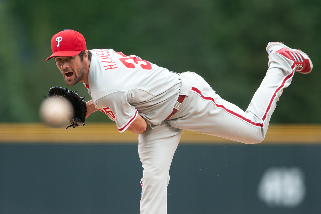 . DENVER, CO - JUNE 16:  Cole Hamels #35 of the Philadelphia Phillies pitches against the Colorado Rockies in the first inning of a game at Coors Field on June 16, 2013 in Denver, Colorado.  (Photo by Dustin Bradford/Getty Images)