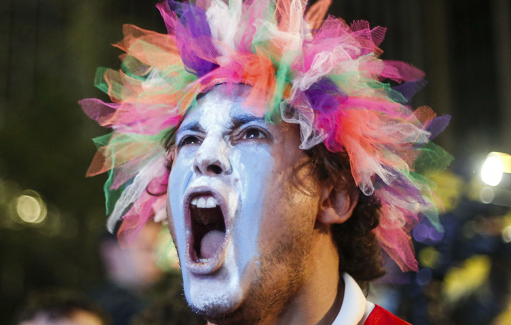 . An Argentine fan celebrates while watching the FIFA World Cup Brazil 2014 semi-final football match against Netherlands in Sao Paulo, Brazil on July 9, 2014. Argentina beat the Netherlands 4-2 in penalty kicks and will face Germany in the FIFA World Cup final on July 13.  Miguel Schincariol/AFP/Getty Images