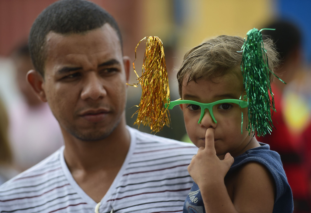 . A young fan waits to see the training session of Cameroon\'s national football team at the Kleber Andrade stadium in Vitoria on June 10, 2014 ahead of the 2014 FIFA World Cup football tournament in Brazil. AFP PHOTO / PIERRE-PHILIPPE MARCOU/AFP/Getty Images
