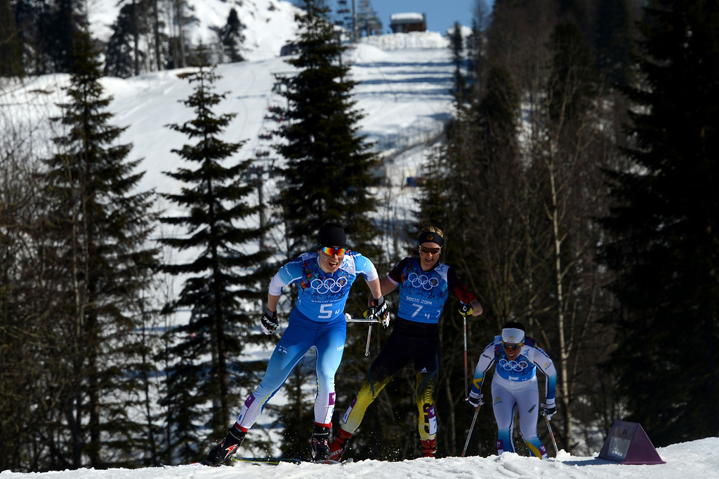 . Sweden\'s Charlotte Kalla (R), Finland\'s Krista Lahteenmaki (L) and Germany\'s Denise Herrmann compete in the Women\'s Cross-Country Skiing 4x5km Relay at the Laura Cross-Country Ski and Biathlon Center during the Sochi Winter Olympics on February 15, 2014, in Rosa Khutor, near Sochi. KIRILL KUDRYAVTSEV/AFP/Getty Images