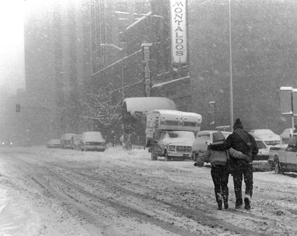 . A couple venturing out during the Blizzard of \'82. Denver Post Library Archive