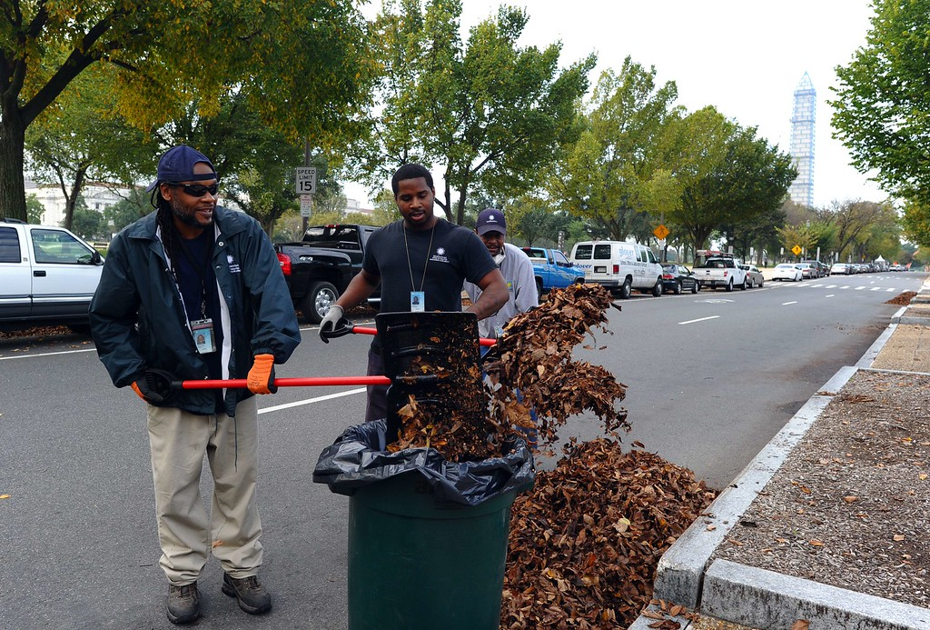 . Smithsonian museum workers clean leaves from a street in Washington, DC, on October 17, 2013, a day after a bipartisan bill was passed by the House and the Senate to reopen the government and raise the debt limit. AFP Photo/Jewel SAMAD/AFP/Getty Images