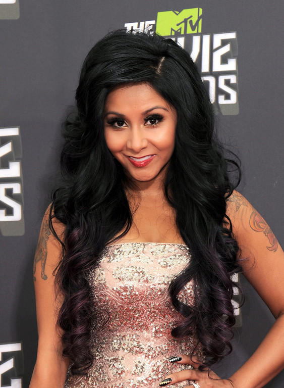 ". Nicole ""Snooki\"" Polizzi arrives at the MTV Movie Awards in Sony Pictures Studio Lot in Culver City, Calif., on Sunday April 14, 2013. (Photo by Jordan Strauss/Invision/AP)"