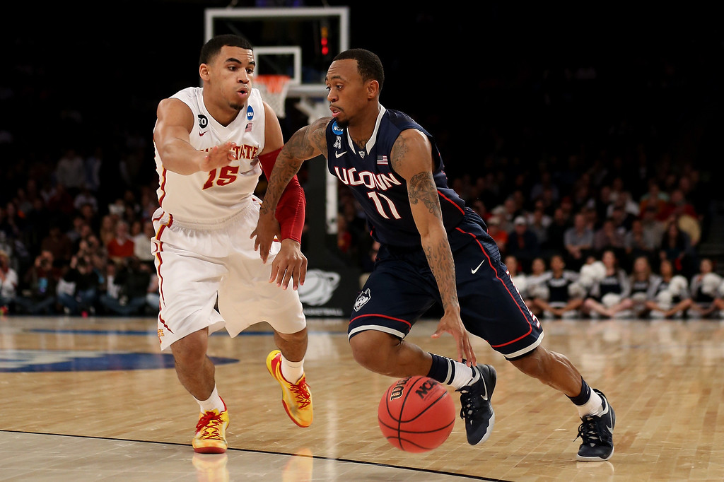 . Ryan Boatright #11 of the Connecticut Huskies handles the ball against Naz Long #15 of the Iowa State Cyclones during the regional semifinal of the 2014 NCAA Men\'s Basketball Tournament at Madison Square Garden on March 28, 2014 in New York City.  (Photo by Bruce Bennett/Getty Images)
