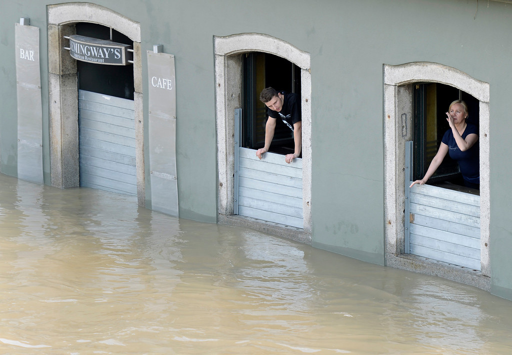 . Residents look out of a restaurant flooded by the river Danube in Passau, southern Germany, on June 5, 2013.     AFP PHOTO / CHRISTOF STACHE/AFP/Getty Images