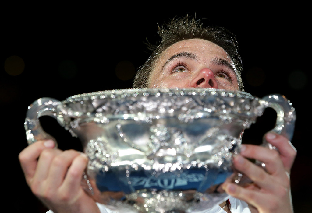 . Stanislas Wawrinka of Switzerland holds up the trophy after defeating Rafael Nadal of Spain during the men\'s singles final at the Australian Open tennis championship in Melbourne, Australia, Sunday, Jan. 26, 2014.(AP Photo/Aaron Favila)
