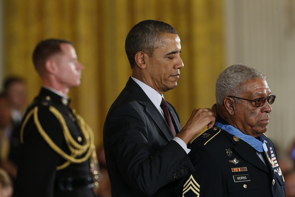 . U.S. Army Staff Sgt. (Ret.) Melvin Morris (R), a Vietnam War veteran, receives the Medal of Honor from U.S. President Barack Obama at the White House on March 18, 2014 in Washington, DC.  Melvin Morris, U.S. Army Sgt. First Class (Ret.) Jose Rodela and U.S. Army Specialist Four (Ret.) Santiago J. Erevia were joined by the families of 21 others who were presented posthumously with the Medal of Honor. Following a congressionally mandated review to ensure that eligible recipients were not bypassed due to prejudice, the veterans received the Medal of Honor for action during major combat operations in World War II, the Korean War and the Vietnam War.  (Photo by Win McNamee/Getty Images)