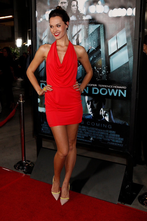 ". Model Laura James from ""Americas Next Top Model\"" poses at the premiere of the new film \""Dead Man  Down\"" in Hollywood, California February 26, 2013. REUTERS/Fred Prouser"