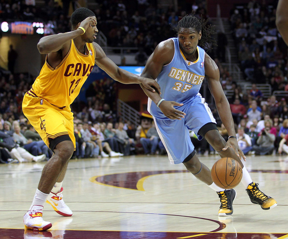 . Denver Nuggets Kenneth Faried (R) dribbles down the lane past Cleveland Cavaliers defender Tristan Thompson (L) during the first quarter of their NBA basketball game in Cleveland, February 9, 2013.REUTERS/Aaron Josefczyk