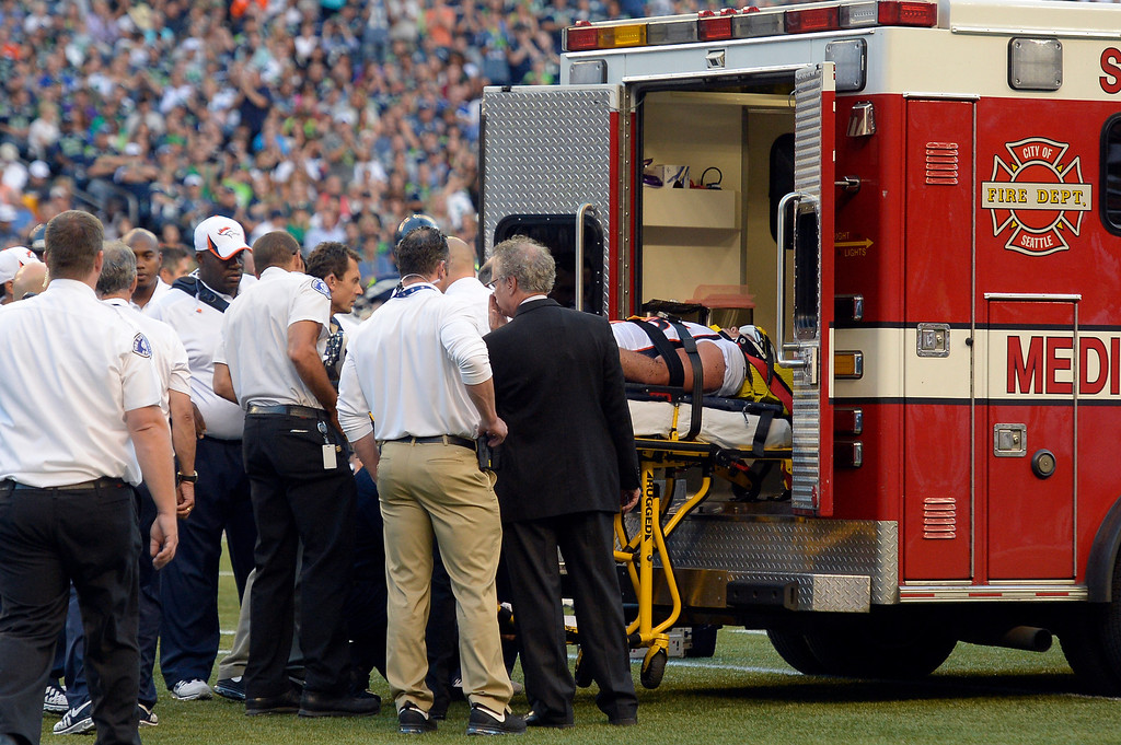. SEATTLE, WA. - AUGUST 17: Denver Broncos defensive end Derek Wolfe (95) is loaded on the ambulance after suffering an injury in the first quarter against the Seattle Seahawks August 17, 2013 at Century Link Field. (Photo By John Leyba/The Denver Post)