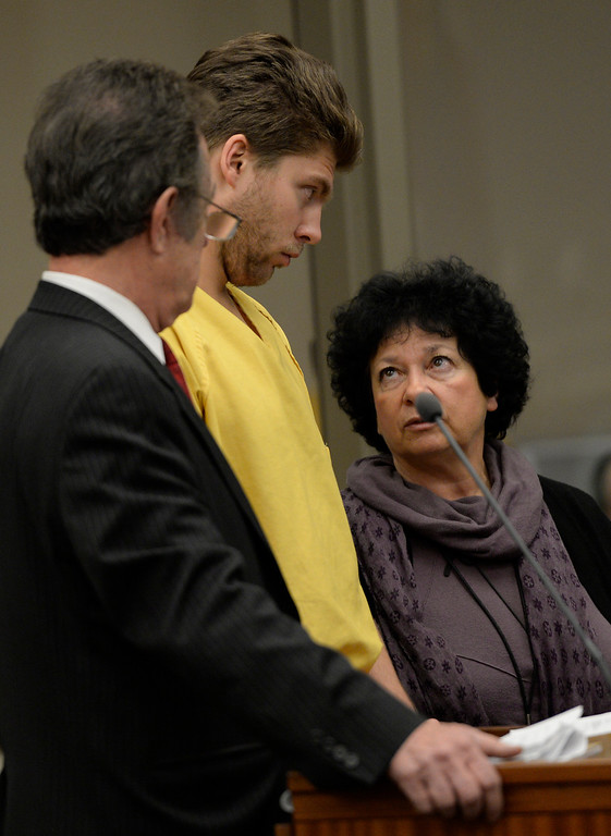 . Semyon Varlamov, starting goaltender for the Colorado Avalanche, between his attorney Jack Rotole, left, and a russian interpreter, appears in court in Denver on kidnapping and assault charges related to the case, which the woman said happened Monday at their apartment, October 31, 2013. The judge set his bond at $5,000. (Photo By RJ Sangosti/The Denve
