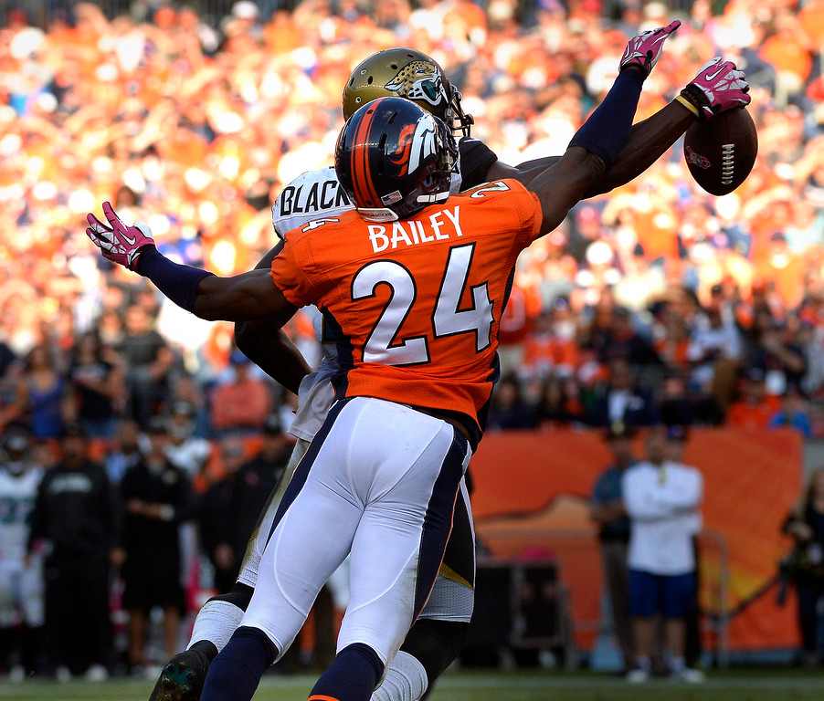 . October 13: Denver Broncos cornerback Champ Bailey #24 knocks away a pass to Jacksonville Jaguars wide receiver Justin Blackmon #14 late in the 4th quarter at Sports Authority Field at Mile High. August 13, 2013 Denver, October. (Photo By Joe Amon/The Denver Post)