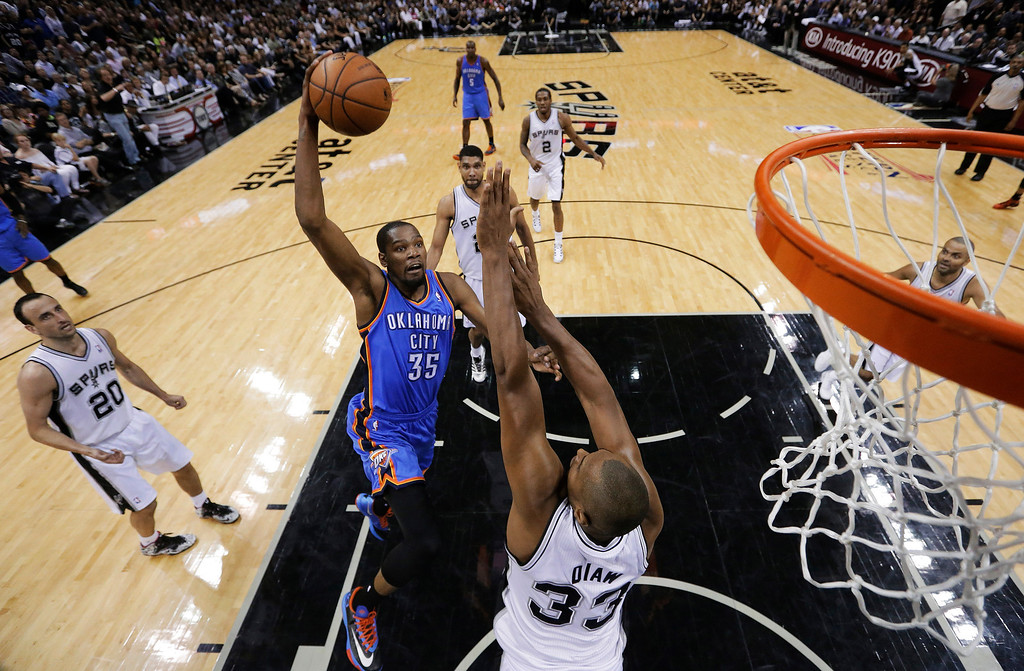 . Oklahoma City Thunder\'s Kevin Durant (35) shoots over San Antonio Spurs\' Boris Diaw (33), of France, during the first half of Game 5 of the Western Conference finals NBA basketball playoff series, Thursday, May 29, 2014, in San Antonio. (AP Photo/Eric Gay)