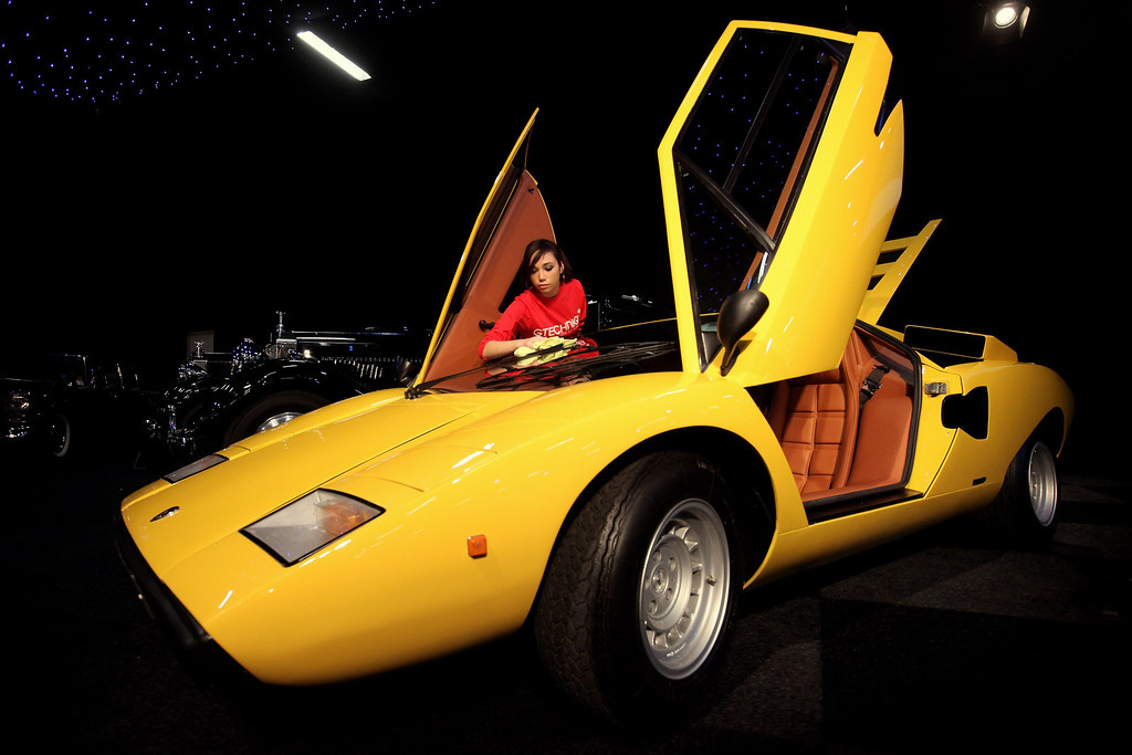 . A woman cleans a 1975 Lamborghini Countach LP400 \'Periscopo\', which is up for auction with an estimated sale price of 240,000 GBP, at the \'Automobiles of London\' rare car auction in Battersea Park on Ocotber 27, 2010 in London, England.    (Photo by Oli Scarff/Getty Images)