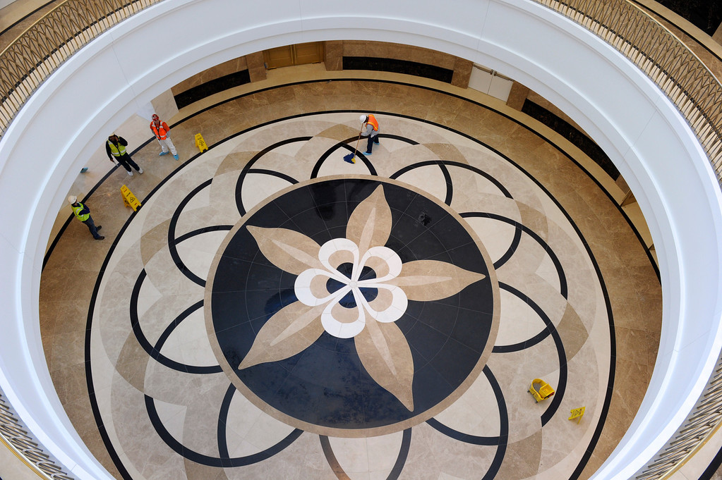 . The columbine flower motif can be seen throughout the courthouse including the floor of the atrium just as you enter the building. Construction crews put the finishing touches on the new Ralph L. Carr Colorado Judicial Center at 2 East 14th Avenue in Denver on Tuesday, Dec. 11, 2012. The courts will officially open at this location at 8 a.m. on Wed. Dec. 19, 2012. Kathryn Scott Osler, The Denver Post