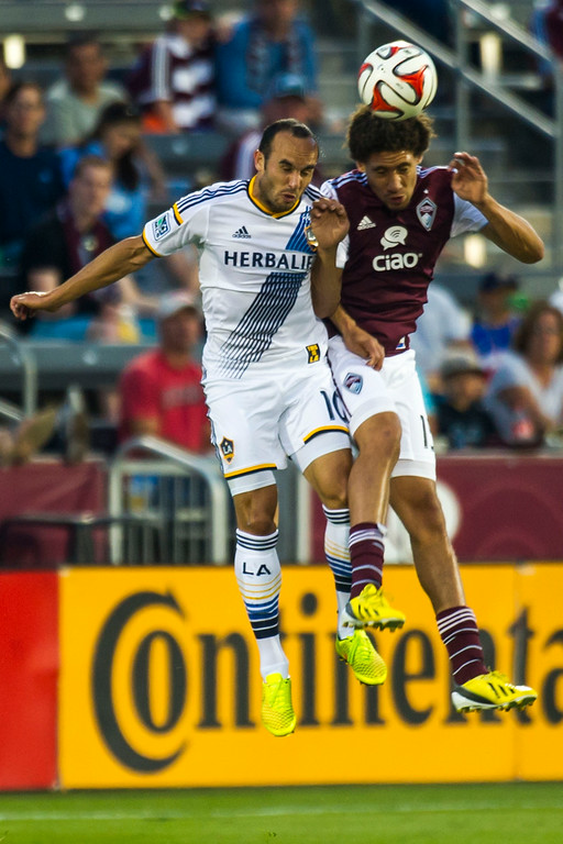 . COMMERCE CITY, CO - AUGUST 20:  Landon Donovan (10) of Los Angeles Galaxy and Chris Klute (15) of Colorado Rapids head the ball during a Major League Soccer game at Dick\'s Sporting Goods Park on Wednesday, August 20, 2014 in Commerce City, Colorado.  Director Comey\'s visit to the Dick\'s Sporting Goods Park is part of his plan to visit all FBI Field Offices in his first year as director.  (Photo by Kent Nishimura/The Denver Post)