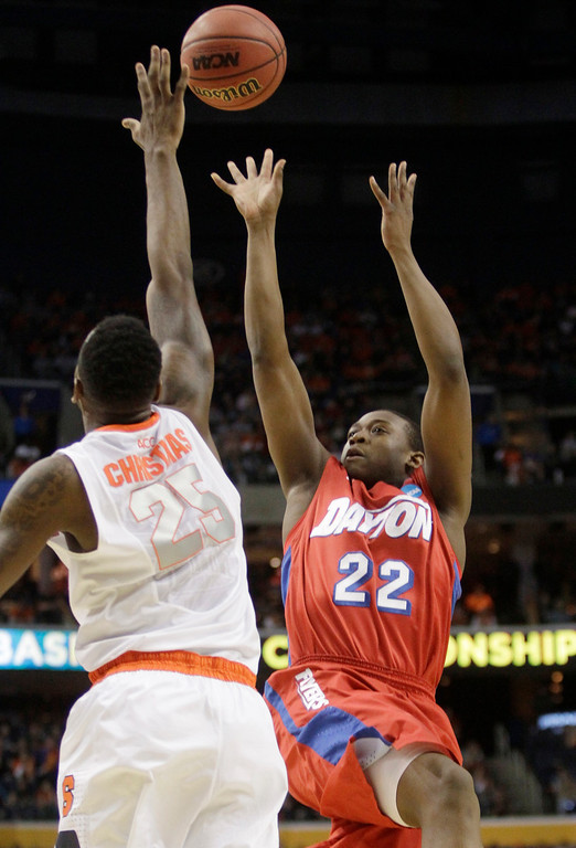 . Dayton\'s Kendall Pollard (22) shoots over Syracuse\'s Rakeem Christmas (25) during the first half of a third-round game in the NCAA men\'s college basketball tournament in Buffalo, N.Y., Saturday, March 22, 2014. (AP Photo/Bill Wippert)