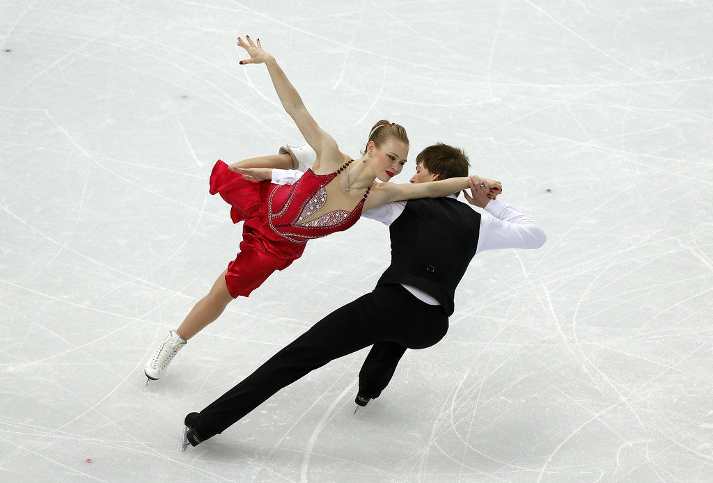 . Ukraine\'s Siobhan Heekin-Canedy and Dmitri Dun perform in the Figure Skating Ice Dance Short Dance at the Iceberg Skating Palace during the Sochi Winter Olympics on February 16, 2014.  ADRIAN DENNIS/AFP/Getty Images