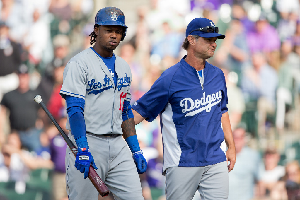 . DENVER, CO - JUNE 7:  Manager Don Mattingly consoles Hanley Ramirez #13 of the Los Angeles Dodgers after Ramirez struck out during the ninth inning against the Colorado Rockies at Coors Field on June 7, 2014 in Denver, Colorado. The Rockies defeated the Dodgers 5-4 in 10 innings to end their eight game losing streak. (Photo by Justin Edmonds/Getty Images)