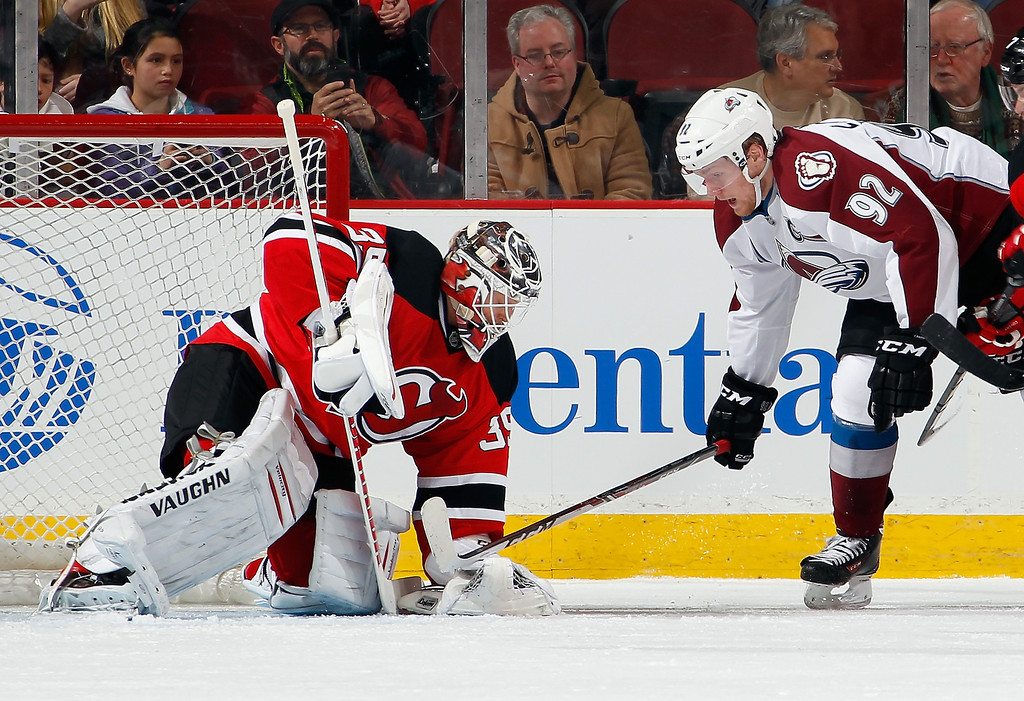 . Goalie Cory Schneider #35 of the New Jersey Devils stops a shot by Gabriel Landeskog #92 of the Colorado Avalanche during the second period of an NHL hockey game at Prudential Center on February 3, 2014 in Newark, New Jersey.  (Photo by Paul Bereswill/Getty Images)