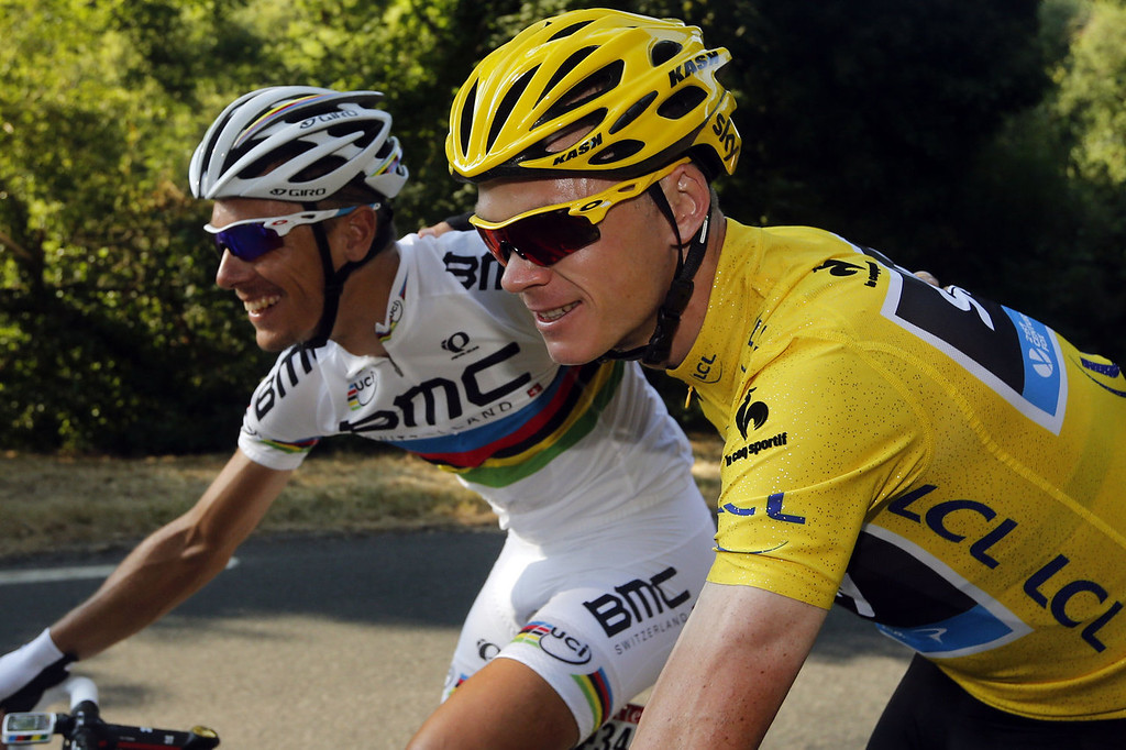 . Overall leader\'s yellow jersey Britain\'s Christopher Froome (R) poses with Belgium\'s Philippe Gilbert as they ride before the start of the 133.5 km twenty-first and last stage of the 100th edition of the Tour de France cycling race on July 21, 2013 between Versailles and Paris.  JOEL SAGET/AFP/Getty Images