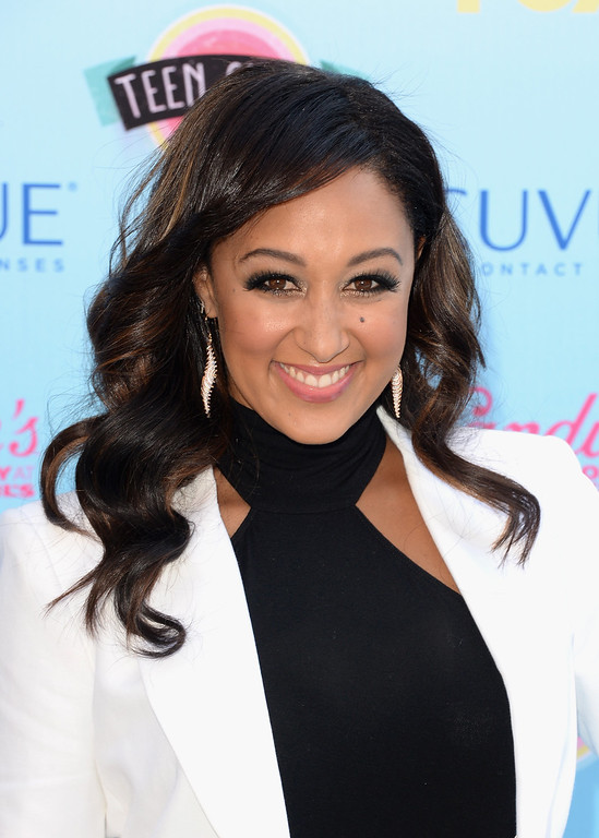 . Actress Tamera Mowry attends the Teen Choice Awards 2013 at Gibson Amphitheatre on August 11, 2013 in Universal City, California.  (Photo by Jason Merritt/Getty Images)