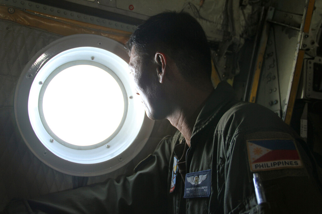. In this photo taken Tuesday, March 11, 2014 released by the Philippine Air Force Western Command, Philippine Air Force C-130 crew members continue their search and rescue mission over the South China Sea more than four days after a Malaysia Airlines jetliner went missing en route to Beijing. Authorities acknowledged Wednesday they didn\'t know which direction the plane carrying 239 passengers was heading when it disappeared, vastly complicating efforts to find it. Several dozen ships and aircraft from some 12 countries are continuing the search for the missing Boeing 777. (AP Photo/Philippine Air Force Western Command)