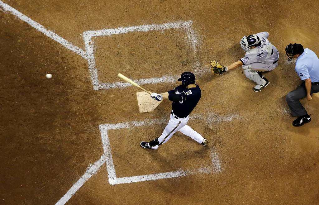 . Milwaukee Brewers\' Ryan Braun hits a game-winning single during the ninth inning of a baseball game against the Colorado Rockies Friday, June 27, 2014, in Milwaukee. The Brewers won 3-2. (AP Photo/Morry Gash)