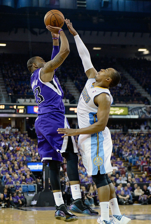 . SACRAMENTO, CA - OCTOBER 30:  Marcus Thornton #23 of the Sacramento Kings shoots over Jordan Hamilton #1 of the Denver Nuggets during the fourth quarter at Sleep Train Arena on October 30, 2013 in Sacramento, California. The Kings won the game 90-88. NOTE TO USER: User expressly acknowledges and agrees that, by downloading and or using this photograph, User is consenting to the terms and conditions of the Getty Images License Agreement. (Photo by Thearon W. Henderson/Getty Images)