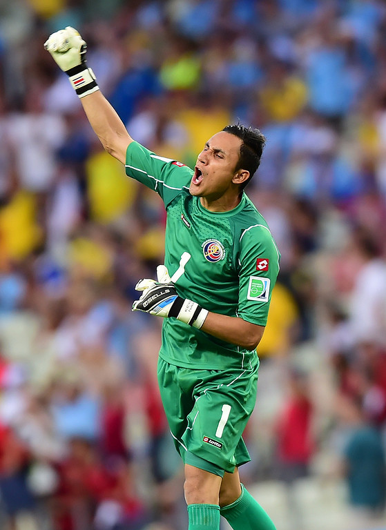 . Costa Rica\'s goalkeeper Keylor Navas celebrates after Costa Rica\'s defender Oscar Duarte (not seen) scored his team\'s second goal during a Group D football match between Uruguay and Costa Rica at the Castelao Stadium in Fortaleza during the 2014 FIFA World Cup on June 14, 2014.  AFP PHOTO / RONALDO SCHEMIDT