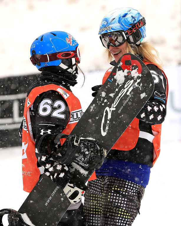 . (L-R) Maelle Ricker and Dominique Maltais of Canada celebrate after winning the USANA Snowboardcross World Cup Team Event on December 15, 2012 in Telluride, Colorado.  (Photo by Doug Pensinger/Getty Images)
