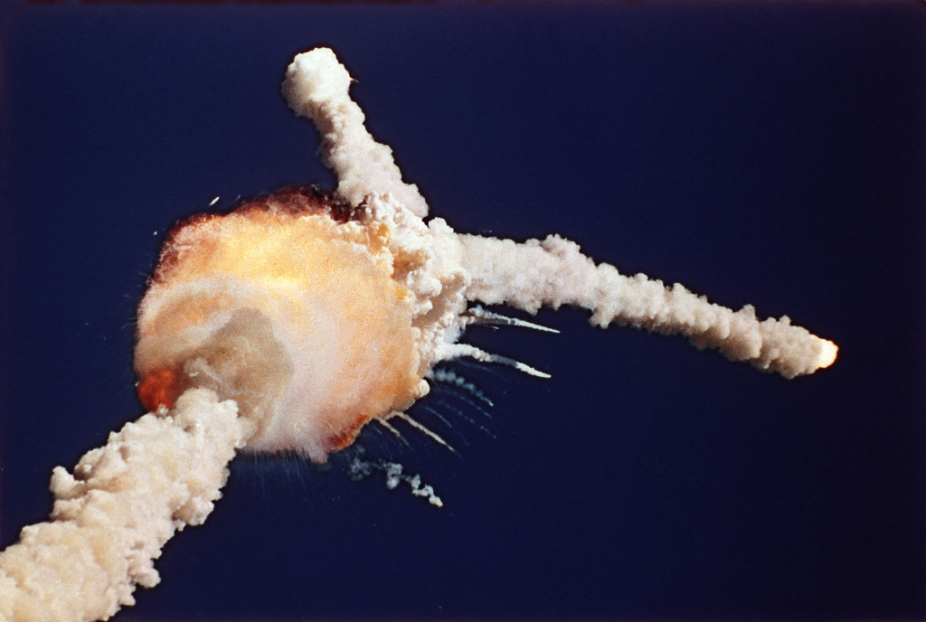 . The Space Shuttle Challenger explodes shortly after lifting off from Kennedy Space Center, Fla., Tuesday, Jan. 28, 1986.  All seven crew members died in the explosion, which was blamed on faulty o-rings in the shuttle\'s booster rockets. The Challenger\'s crew was honored with burials at Arlington National Cemetery.  (AP Photo/Bruce Weaver)
