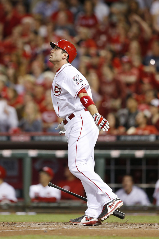 . CINCINNATI, OH - MAY 9: Joey Votto #19 of the Cincinnati Reds watches his game-winning home run in the bottom of the ninth inning of the game against the Colorado Rockies at Great American Ball Park on May 9, 2014 in Cincinnati, Ohio. The Reds won 4-3. (Photo by Joe Robbins/Getty Images)