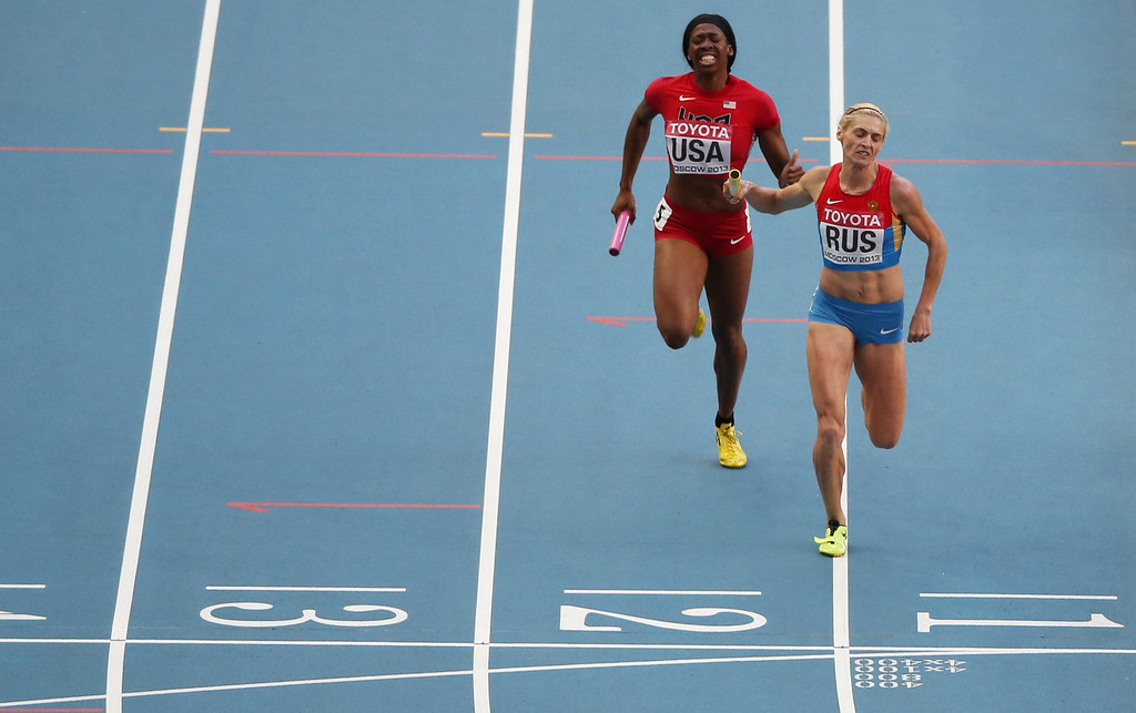 . US Francena McCorory (L) adn Russia\'s Antonina Krivoshapka run for the line during the women\'s 4x400 metres relay final at the 2013 IAAF World Championships at the Luzhniki stadium in Moscow on August 17, 2013.  LOIC VENANCE/AFP/Getty Images