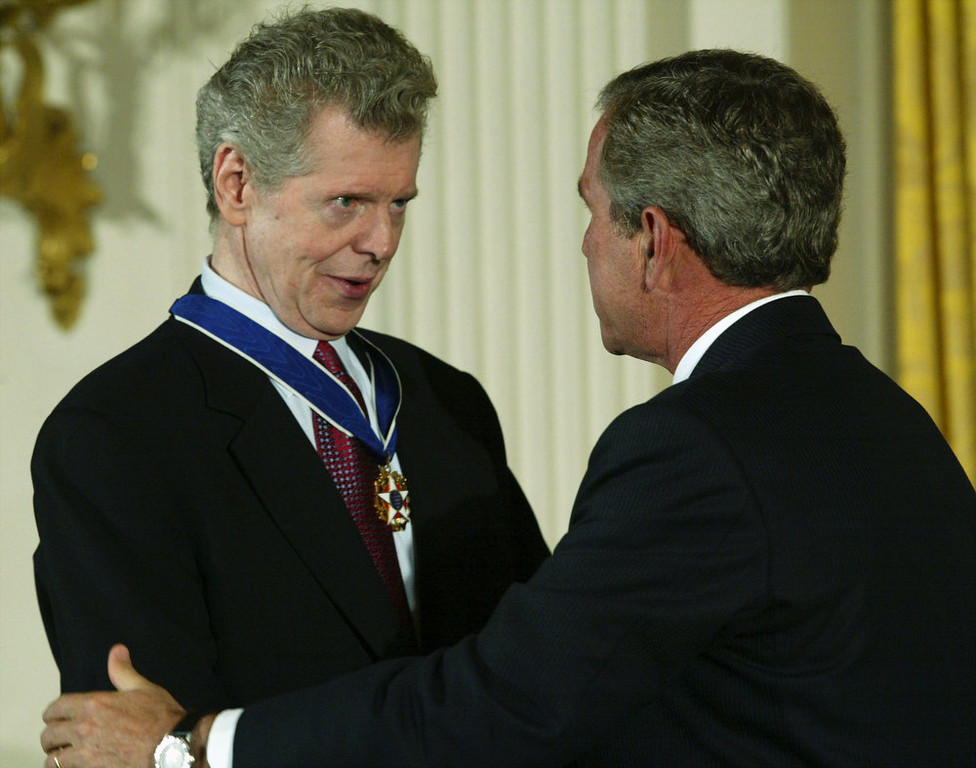 . U.S. President George W. Bush (R) talks to pianist Van Cliburn after presenting Cliburn with a Presidential Medal of Freedom during an East Room event at the White House on July 23, 2003 in Washington, DC. Cliburn was honored as a skilled musician and for his contributions to the arts.  (Photo by Alex Wong/Getty Images)
