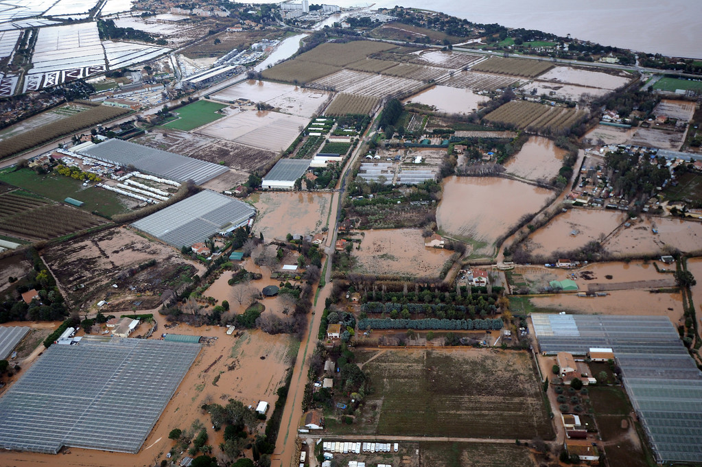 . A general view taken from a helicopter shows flooded areas near Hy�res, southern France, Monday, Dec. 20, 2014. Unusually heavy rains have flooded the French Riviera, leaving two people dead and thousands without electricity or access to roads. The administration for the Var region evacuated some residents and urged others to stay indoors until the waters recede. (AP Photo/ Anne-Christine Poujoulat, Pool)