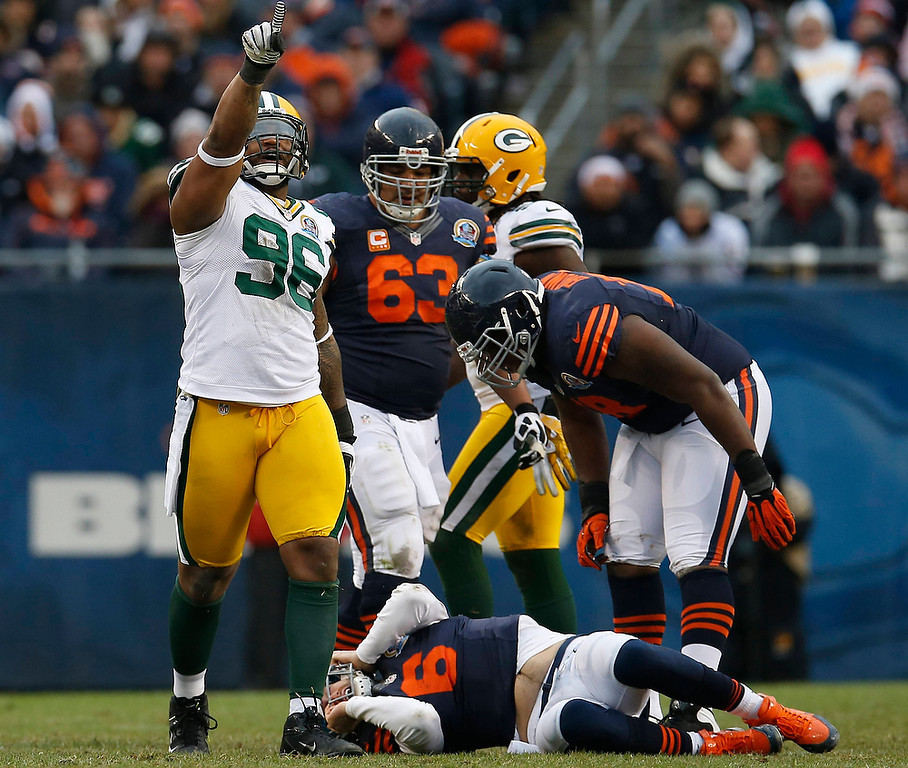 . Green Bay Packers\' Jordan Miller (96) celebrates his sack on Chicago Bears\' Jay Cutler (6) during the second half of their NFL football game at Soldier Field in Chicago, December 16, 2012.     REUTERS/Jim Young