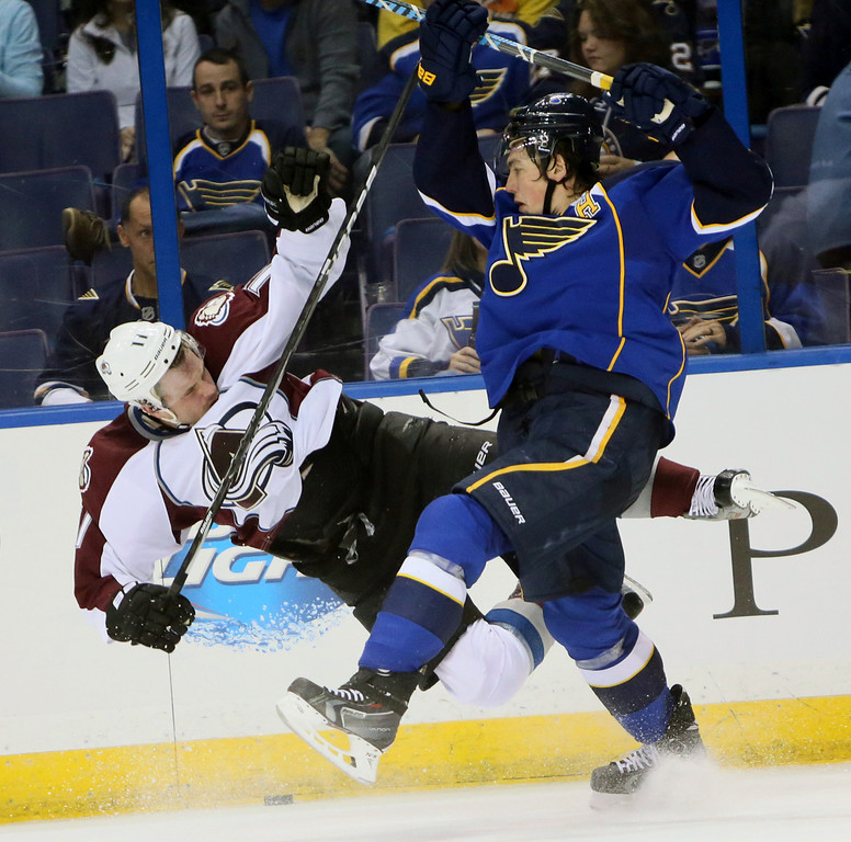 . St. Louis Blues right wing T.J. Oshie, right, collides with Colorado Avalanche left wing Jamie McGinn during the second period of an NHL hockey game, Thursday, Nov. 14, 2013, in St. Louis. (AP Photo/St. Louis Post-Dispatch, Chris Lee)