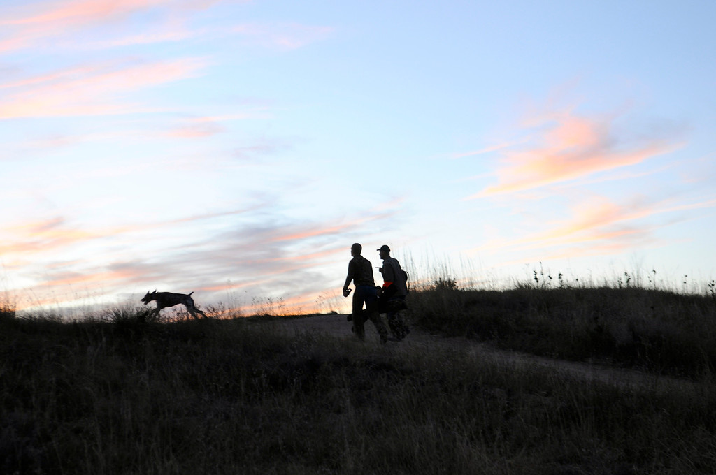 . A trio of tired hunters heads home as the sun sets over the eastern plains on opening day of pheasant season, Saturday, November 9, 2013. Scott Willoughby, The Denver Post