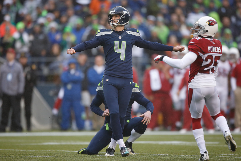 . Kicker Steven Hauschka #4 of the Seattle Seahawks watches the flight of a missed field goal near the end of the first half against the Arizona Cardinals at CenturyLink Field on December 22, 2013 in Seattle, Washington.  (Photo by Otto Greule Jr/Getty Images)
