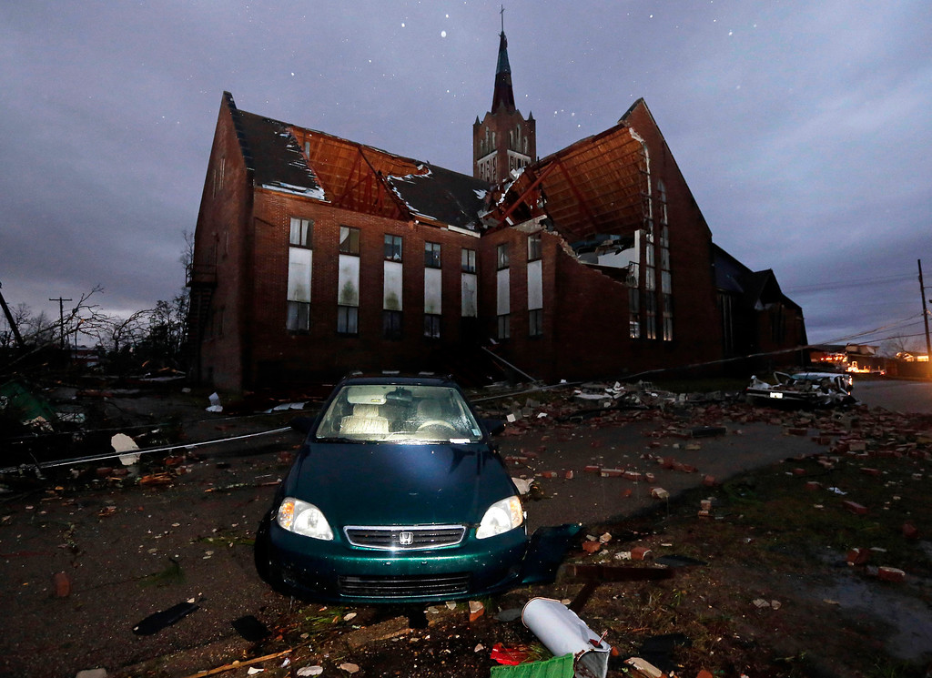 . Early Monday morning sunlight shows the destruction Sunday\'s tornado caused in this Hattiesburg, Miss., neighborhood adjacent to the University of Southern Mississippi, including the severe damage to Westminster Presbyterian Church Feb. 11, 2013. (AP Photo/Rogelio V. Solis)