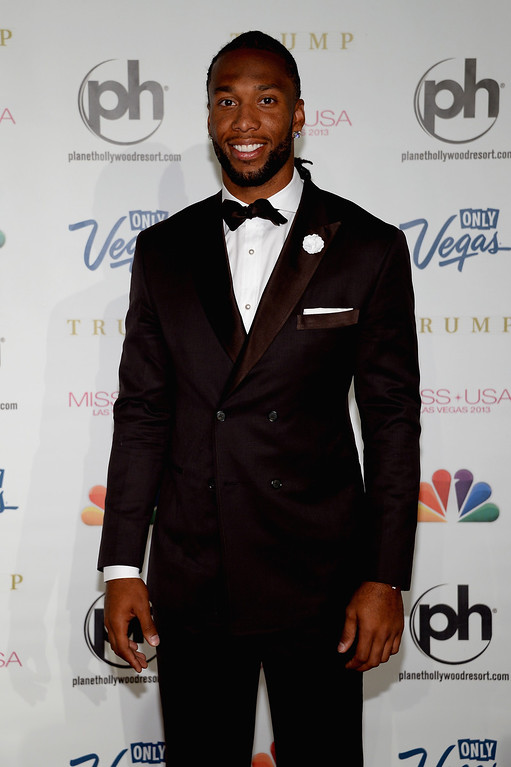 . NFL player and pageant judge Larry Fitzgerald arrives at the 2013 Miss USA pageant at Planet Hollywood Resort & Casino on June 16, 2013 in Las Vegas, Nevada.  (Photo by Ethan Miller/Getty Images)