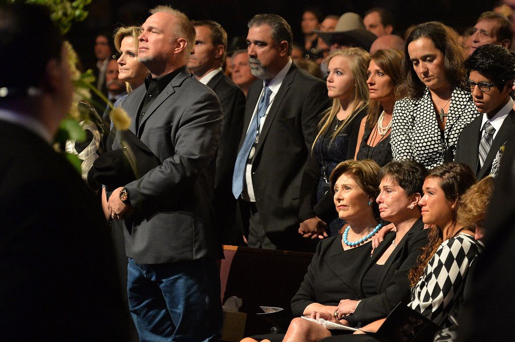. (L-R) Country musicians Trisha Yearwood and Garth Brooks, and Former US First Lady Laura Bush, Nancy Jones, and Breanne Hohimer attend the funeral service for George Jones at The Grand Ole Opry on May 2, 2013 in Nashville, Tennessee.   (Photo by Rick Diamond/Getty Images for GJ Memorial)