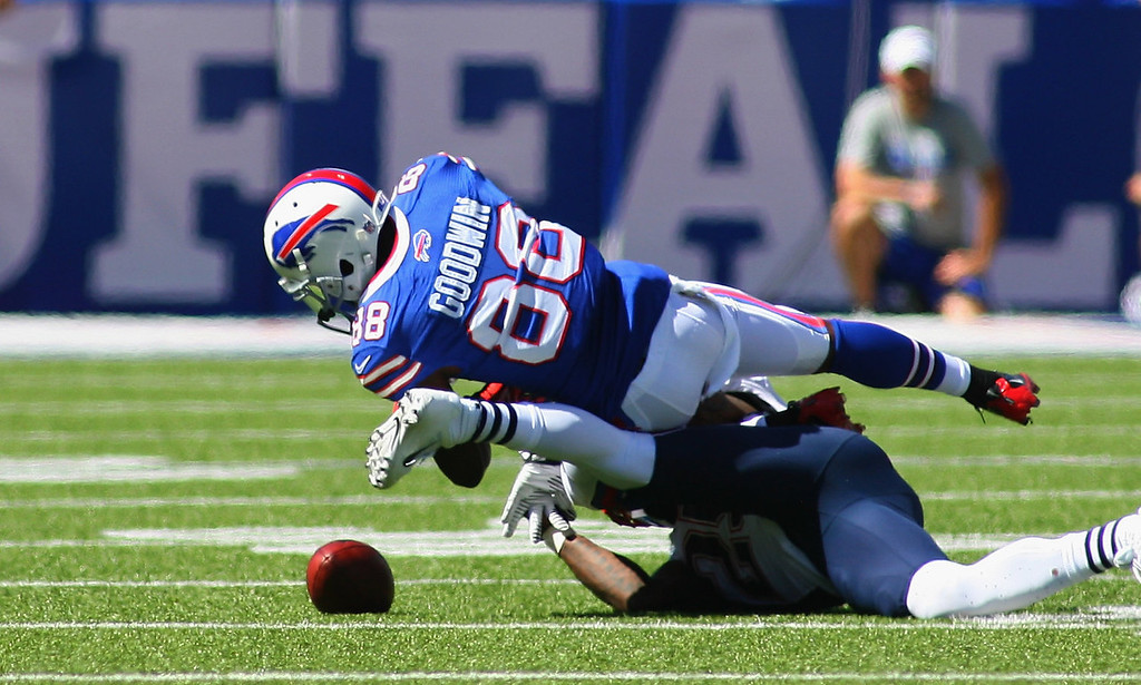 . Marquise Goodwin #86 of the Buffalo Bills fumbles after a catch against the New England Patriots at Ralph Wilson Stadium on September 8, 2013 in Orchard Park, New York.  (Photo by Rick Stewart/Getty Images)
